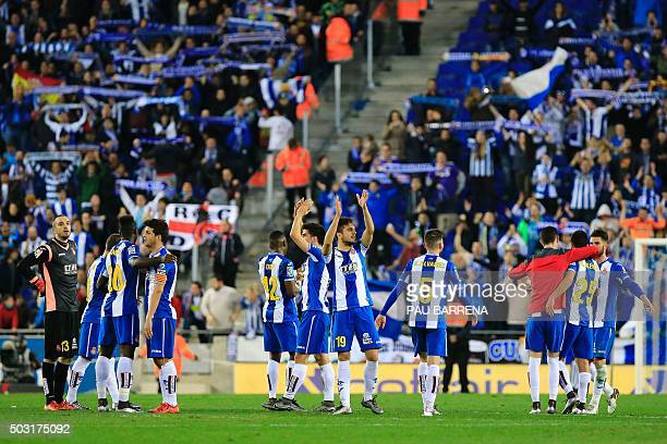 RCD Espanyol players celebrate the final result a 00 draw at the end of the Spanish league football match RCD Espanyol vs FC Barcelona atthe Power8...