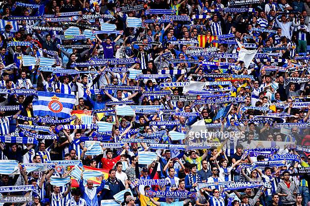 Espanyol supporters cheer on their team during the La Liga match between RCD Espanyol and FC Barcelona at CornellaEl Prat Stadium on April 25 2015 in...