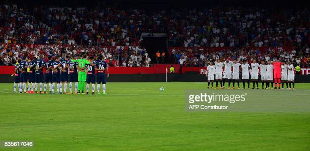 Espanyol's and Sevilla's players observe a minute's silence for the victims of Barcelona's attack before the Spanish league football match Sevilla FC...