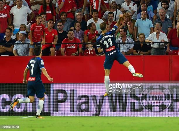 Espanyol's Brazilian forward Leo Baptistao celebrates after scoring during the Spanish league football match Sevilla FC vs Espanyol at the Ramon...