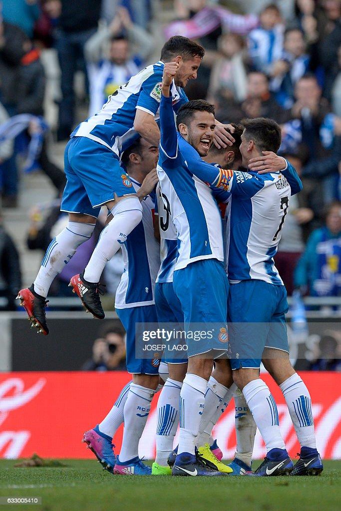 Espanyol's defender Marc Navarro (C) celebrates a goal with teammates during the Spanish league football match RCD Espanyol vs Sevilla FC atthe Cornella-El Prat stadium in Cornella de Llobregat on January 29, 2017. / AFP / Josep Lago