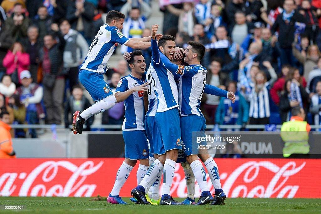 Espanyol's defender Marc Navarro (2R) celebrates a goal with teammates during the Spanish league football match RCD Espanyol vs Sevilla FC atthe Cornella-El Prat stadium in Cornella de Llobregat on January 29, 2017. / AFP / Josep Lago