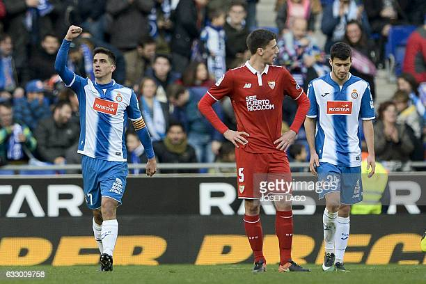 Espanyol's forward Gerard Moreno celebrates his goal beside Sevilla's French defender Clement Lenglet and Espanyol's defender Aaron Caricol during...