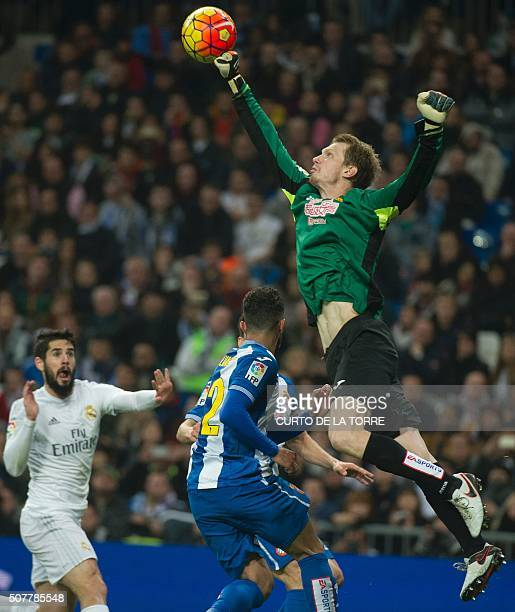 TOPSHOT Espanyol's Lithuanian goalkeeper Giedrius Arlauskis stops the ball during the Spanish league football match Real Madrid CF vs RCD Espanyol at...