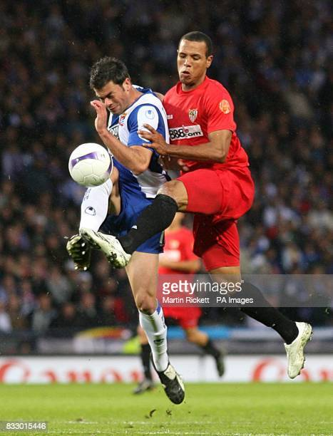 Espanyol's Marc Torrejon and Sevilla's Clemente Luis Fabiano battle for the ball