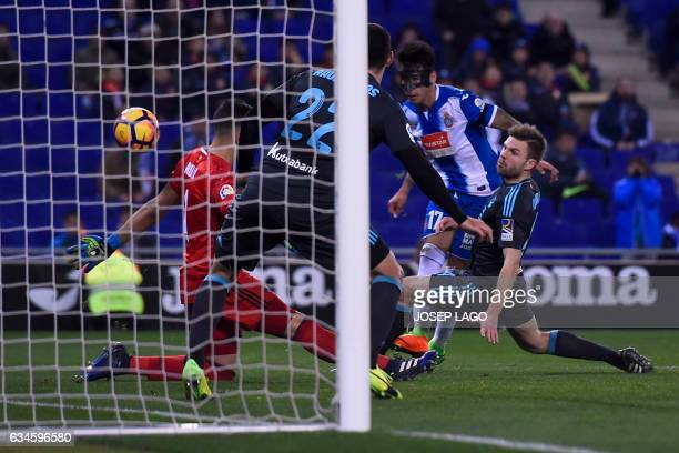 Espanyol's Paraguayan midfielder Hernan Perez scores against Real Sociedad's Argentinian goalkeeper Geronimo Rulli during the Spanish league football...