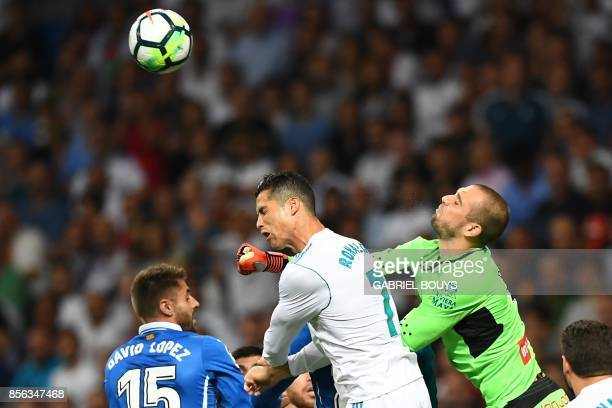 Espanyol's Spanish goalkeeper Pau Lopez and Espanyol's Spanish midfielder David Lopez try to block a header by Real Madrid's Portuguese forward...