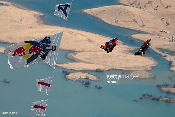 Espen Fadnes of Norway and Vicente Descols of France compete during the Red Bull Aces wingsuit 4 cross race on July 17 2014 in Oakdale California