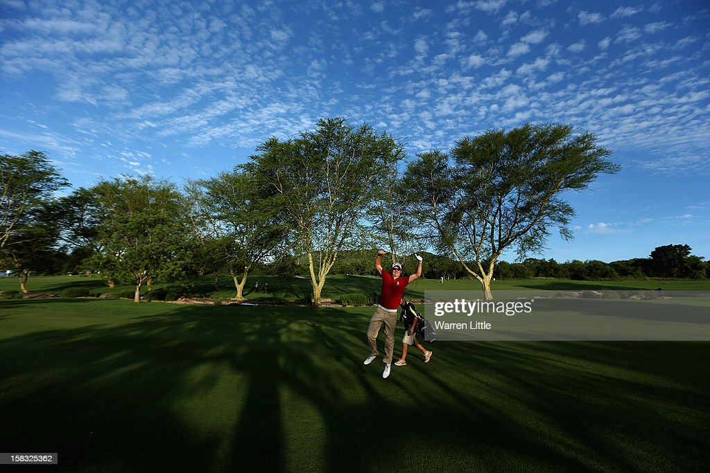 Espen Kofstad of Norway jumps in the air as he poses for a picture during the first round of the Alfred Dunhill Championship at Leopard Creek Country Golf Club on December 13, 2012 in Malelane, South Africa.