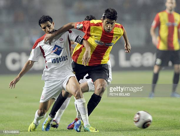 Esperance de Tunis striker Oussama Darragi vies for the ball with Morocco's Wydad Casablanca team captain Farid Talhaoui during their Africa Champion...