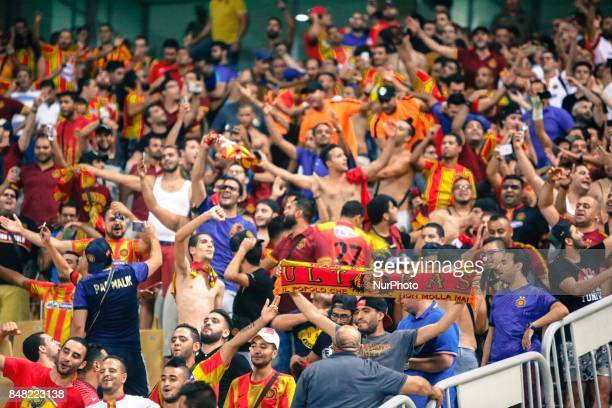 Esperance fans cheer after the CAF Champions League quarterfinal firstleg football match between Egypt's AlAhly and Tunisia's Esperance of Tunis at...