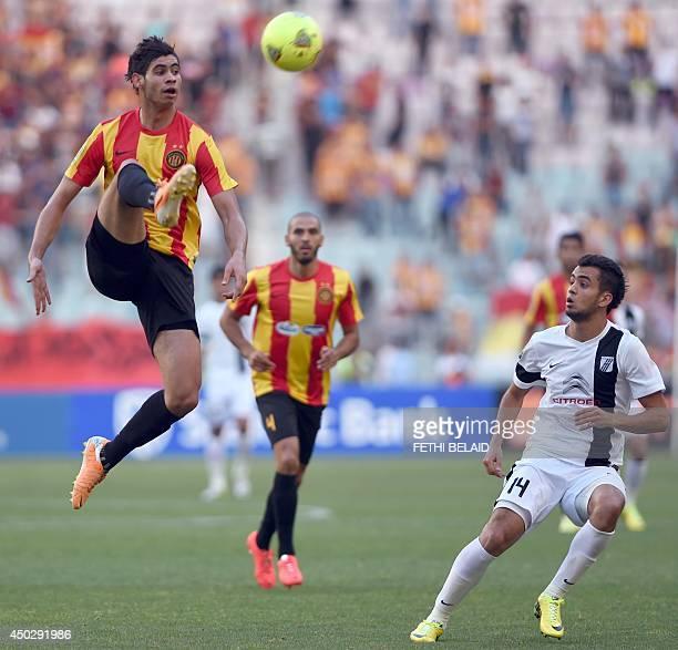 Esperance of Tunis defender Chamsesddine Dhaouadi controls the ball ahead of Tunisia CS Sfax Ghazi Challouf during their CAF Champions League...