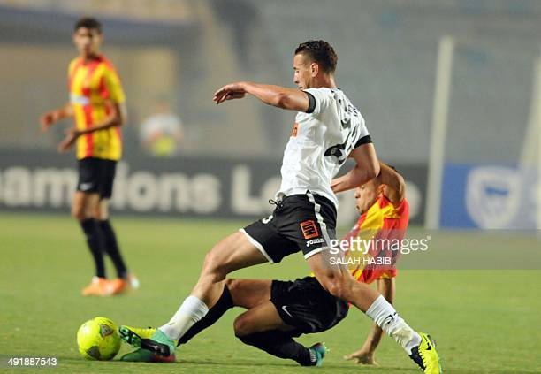 Esperance of Tunis defender Samah Derbali challenges Algeria's ES Setif forward Najid Rachid during their CAF Champions League football match on May...