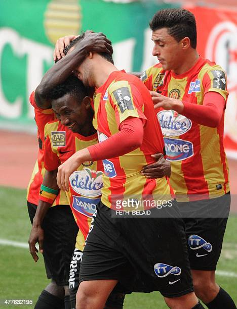 Esperance of Tunis players hug their teammate Striker Hayhem Juini after to scoring against Kenya's Gor Mahia FC during their CAF Champions League...