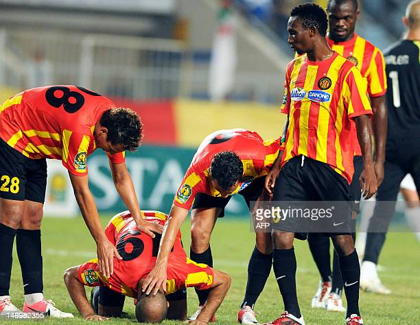 Esperance Tunis' players congratulate their teammate Khaled Mouelhi on scoring against ASO Chlef during their CAF Champions League group A football...