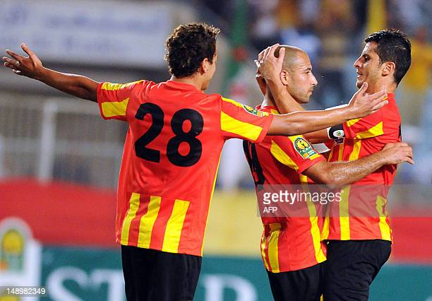 Esperance Tunis' Youssef Msekni and Khalil Chammam congratulate their teammate Khaled Mouelhi on scoring against the Algerian footbal club ASO Chlef...