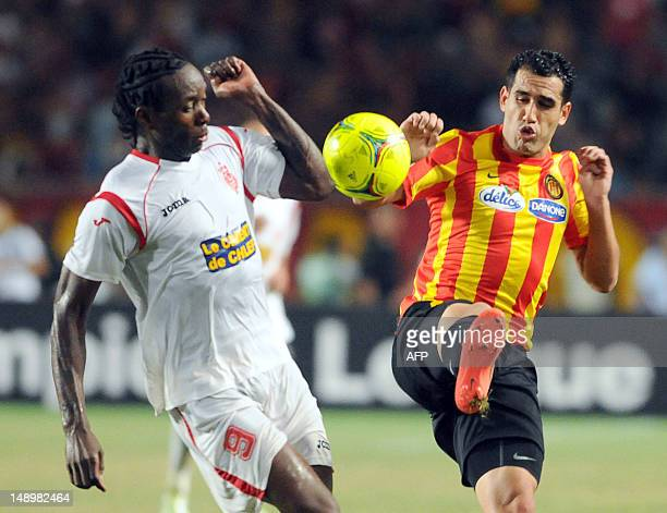Esperance's defender Samah Derbeli vies with ASO Chlef's stricker Eyenga Anicet during the CAF Champions League group A football match between...