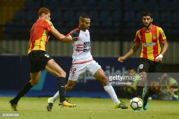 Esperance's Fakhreddine Ben Youssef fights for the ball with Fath Union Sport's Ayoub Skouma during the Arab Club championship semifinal match...