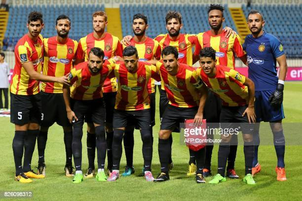 Esperance's players pose before the Arab Club championship semifinal match Tunisian Tunis Esperance against Moroccos Fath Union Sport Rabat at Borg...