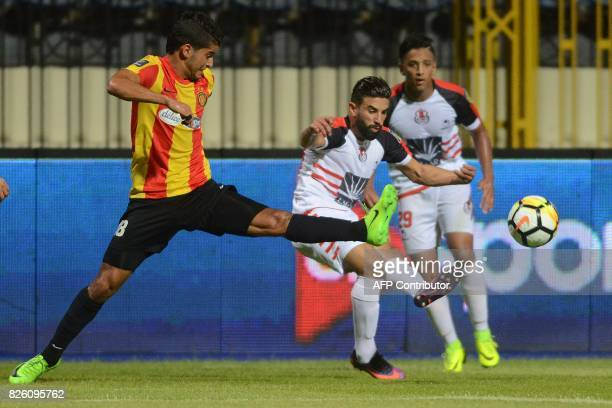 Esperance's Saad Bguir fights for the ball with Fus' Mohamed Fouzair during the Arab Club championship semifinal match Tunisian Tunis Esperance and...