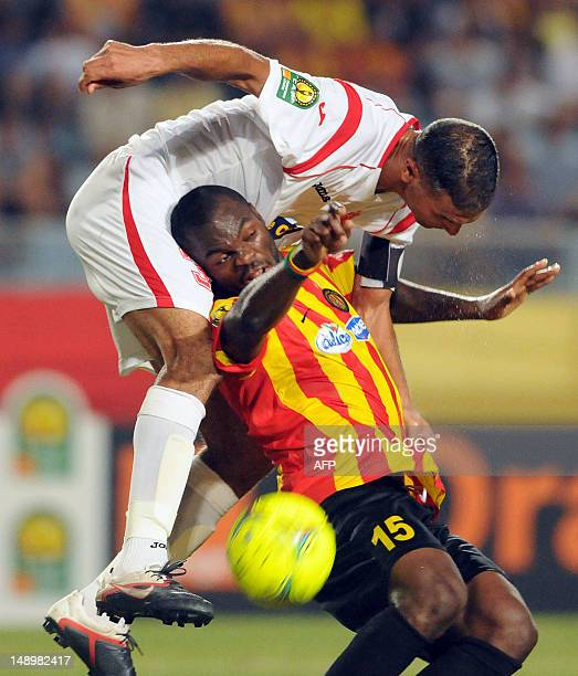 Esperance's striker Yannick N'djeng vies with ASO Chlef's forward Samir Zaoui during the CAF Champions League group A football match between...