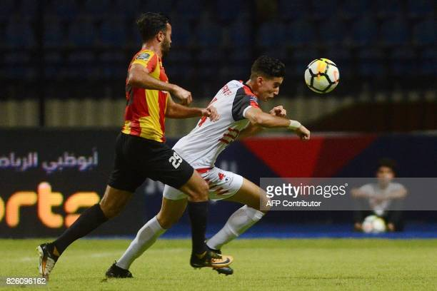 Esperance's Taha Yassine Khenissi fights for the ball with Fath Union Sport's Naif Akrad during the Arab Club championship semifinal match Tunisian...