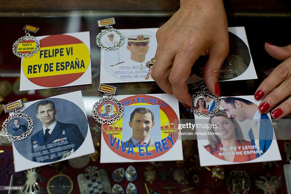 Esperanza displays for the photographer the new Prince Felipe souvenirs on sale as future king of Spain at the 118 hundred years old Celada medal shop on June 11, 2014 in Madrid, Spain. Prince Felipe of Spain will be crowned Felipe VI of Spain on the 19th of June after his father King Juan Carlos of Spain abdicated on June 2,