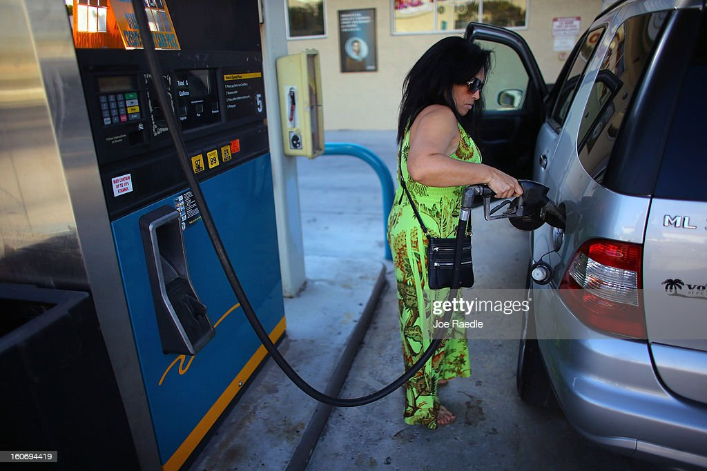 Esperanza Guerra uses a gas station's pump to fill her vehicle with gas on February 4, 2013 in Miami, Florida. Reports indicate that gas pump prices are at their highest level on record for this period of the year and may be an indication that the year ahead may see even higher records.