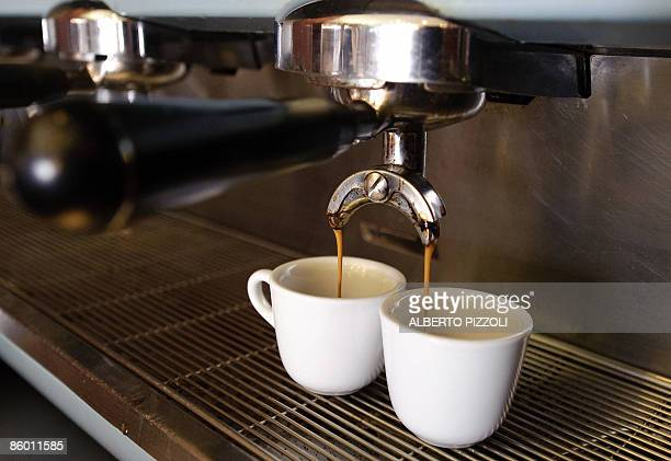 Espresso are being brewed in a bar in centre Rome on April 17 2009 during the 'Espresso Italiano day 2009' Italians drink some 70 million cups of...