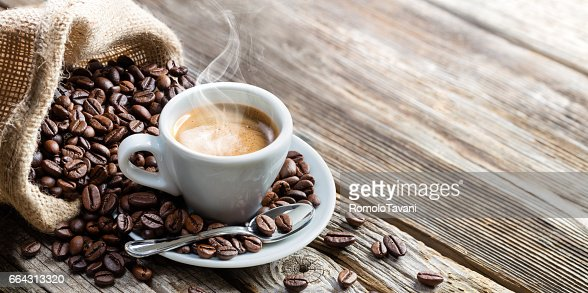 Espresso Coffee Cup With Beans On Vintage Table : Stock Photo