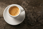 Cup of coffee espresso with foam on top view with copy space. Coffee background