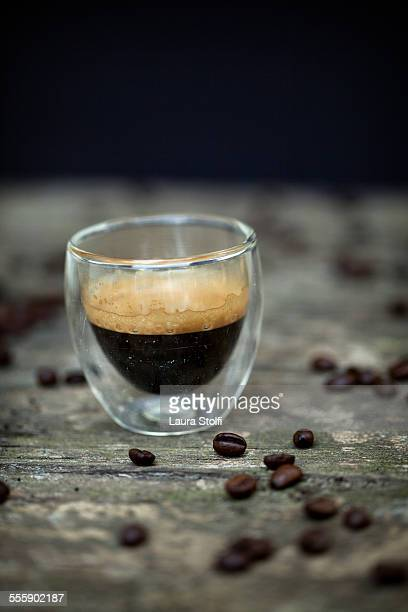 Espresso coffee with foam in glass cup