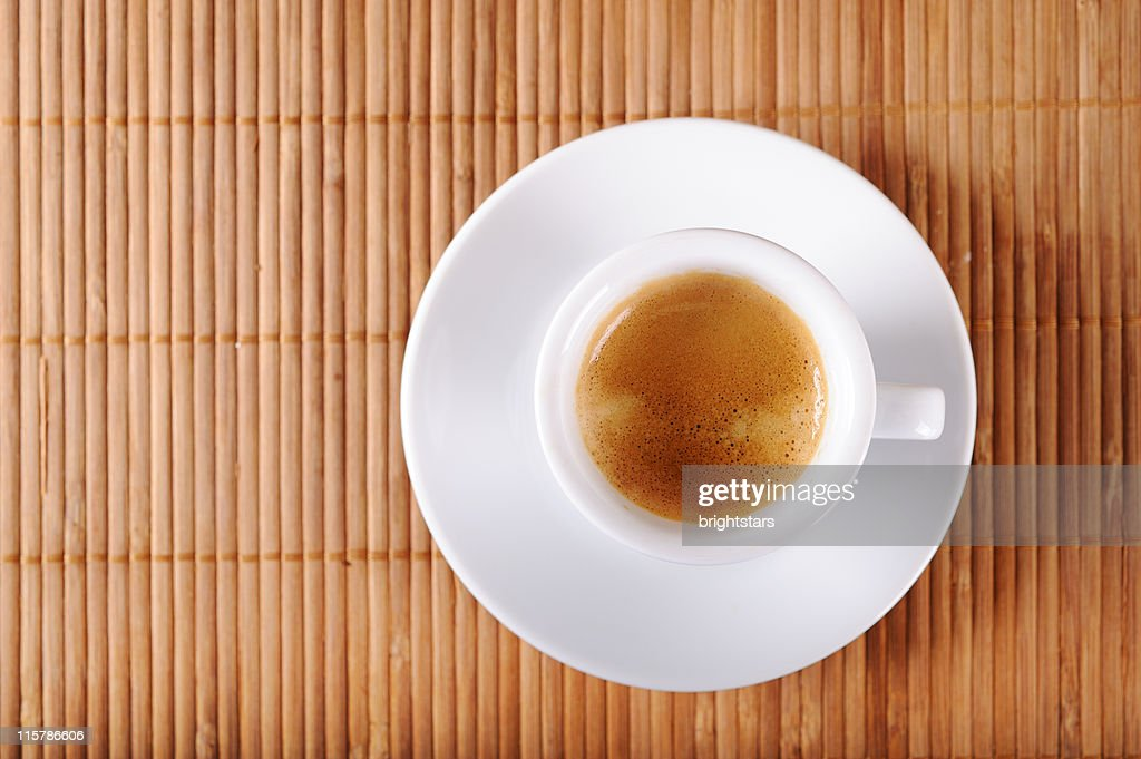 Espresso cup on a mat : Stock Photo