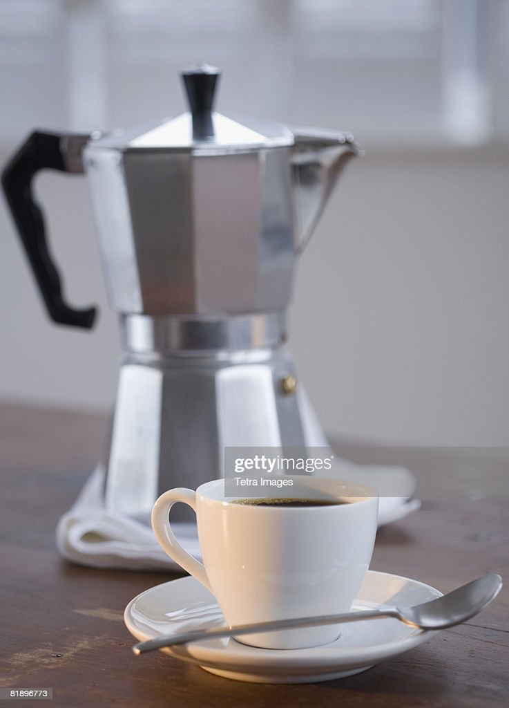 Espresso in front of coffee pot