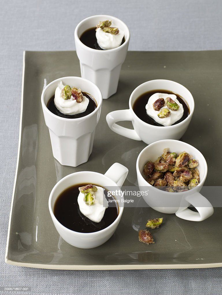 Espresso mousse garnished with candied pistachios : Stock Photo