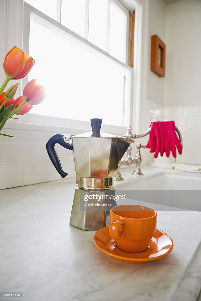 Espresso pot and cup on kitchen counter