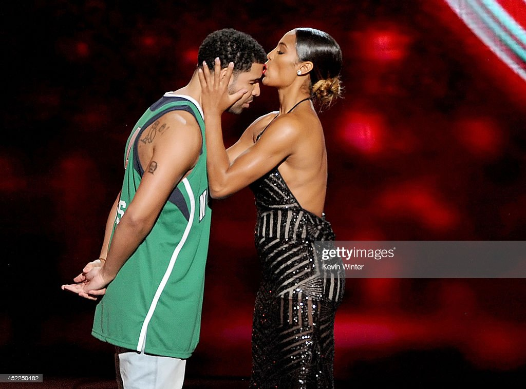 ESPYs host <a gi-track='captionPersonalityLinkClicked' href=/galleries/search?phrase=Drake+-+Entertainer&family=editorial&specificpeople=6927008 ng-click='$event.stopPropagation()'>Drake</a> with WNBA player <a gi-track='captionPersonalityLinkClicked' href=/galleries/search?phrase=Skylar+Diggins&family=editorial&specificpeople=5791961 ng-click='$event.stopPropagation()'>Skylar Diggins</a> onstage during the 2014 ESPYS at Nokia Theatre L.A. Live on July 16, 2014 in Los Angeles, California.