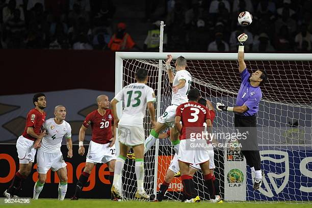 Essam Al Hadary of Egypt saves with the fist during their semi final match of the African Cup of Nations CAN2010 at the Ombaka stadium in Benguela...