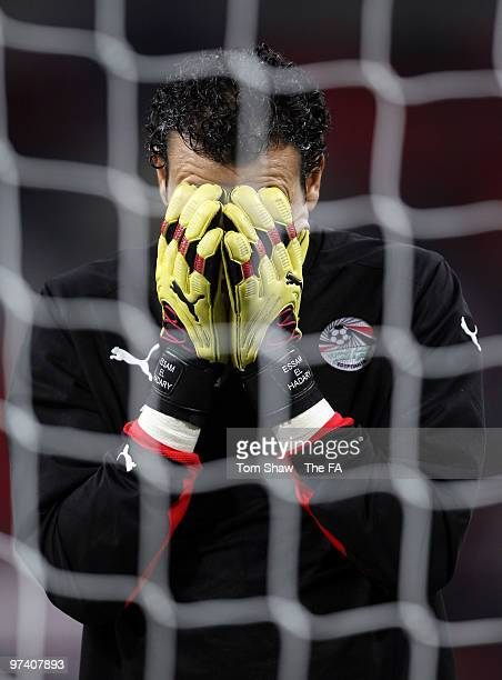 Essam El Hadari of Egypt holds his face during the International Friendly match between England and Egypt at Wembley Stadium on March 3 2010 in...