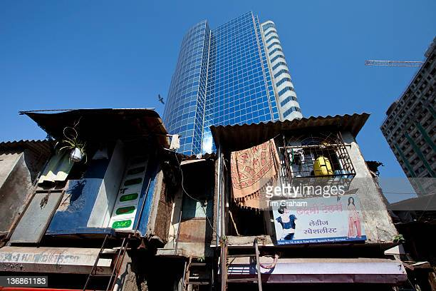 Essar House office development for Essar Group by slums in Mahalaxmi area of Mumbai India shows contrast of rich and poor