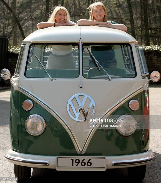 Fair hostesses Sandra and Xenia look out of a Volkswagen Samba bus constructed in 1966 to promote the Techno Classica fair 27 March 2007 in Essen...