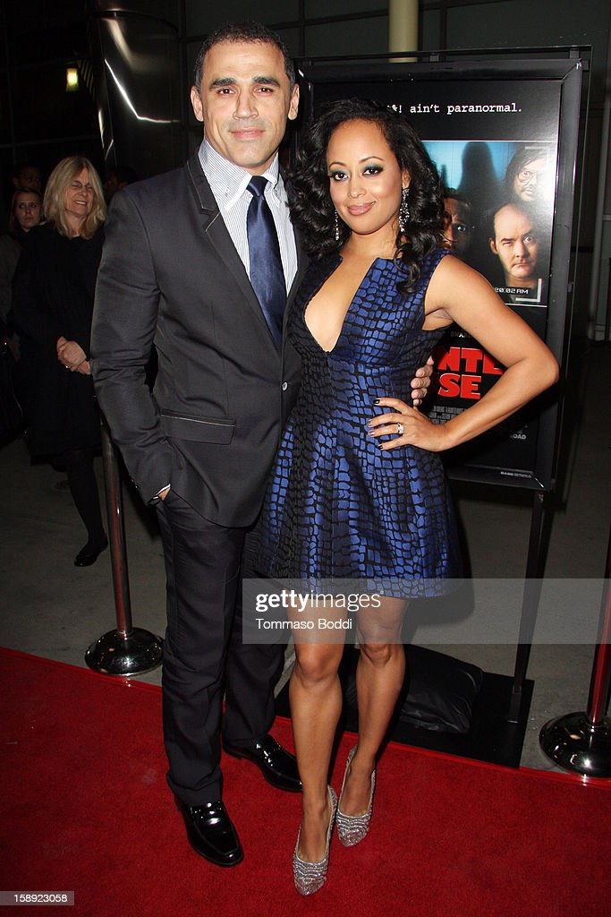 <a gi-track='captionPersonalityLinkClicked' href=/galleries/search?phrase=Essence+Atkins&family=editorial&specificpeople=225171 ng-click='$event.stopPropagation()'>Essence Atkins</a> (R) and guest attend the 'A Haunted House' Los Angeles premiere held at the ArcLight Hollywood on January 3, 2013 in Hollywood, California.