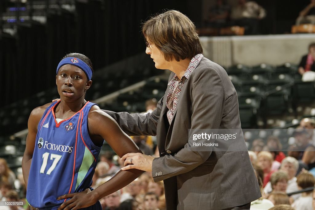 Essence Carson is comforted by head coach Anne Donovan of the New York Liberty during the game against the Indiana Fever at Conseco Fieldhouse on...