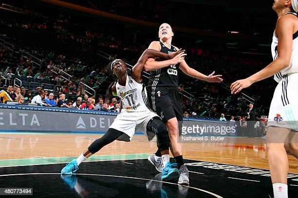 Essence Carson of the New York Liberty battles for position against Jayne Appel of the San Antonio Stars on July 15 2015 at Madison Square Garden in...