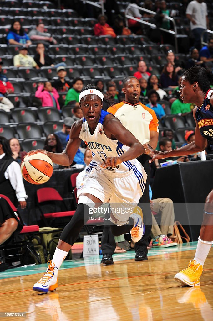 <a gi-track='captionPersonalityLinkClicked' href=/galleries/search?phrase=Essence+Carson&family=editorial&specificpeople=2351517 ng-click='$event.stopPropagation()'>Essence Carson</a> #17 of the New York Liberty drives the basketball against the Connecticut Sun during the WNBA game on May 18, 2013 at the Prudential Center in Newark, New Jersey.
