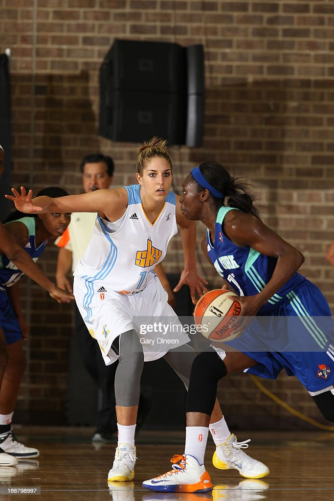 <a gi-track='captionPersonalityLinkClicked' href=/galleries/search?phrase=Essence+Carson&family=editorial&specificpeople=2351517 ng-click='$event.stopPropagation()'>Essence Carson</a> #17 of the New York Liberty moves the ball past <a gi-track='captionPersonalityLinkClicked' href=/galleries/search?phrase=Elena+Delle+Donne&family=editorial&specificpeople=5042380 ng-click='$event.stopPropagation()'>Elena Delle Donne</a> #11 of the Chicago Sky during the pre-season game on May 15, 2013 at the Jacoby D. Dickens Physical Education and Athletic Center on the campus of Chicago State University in Chicago, Illinois.