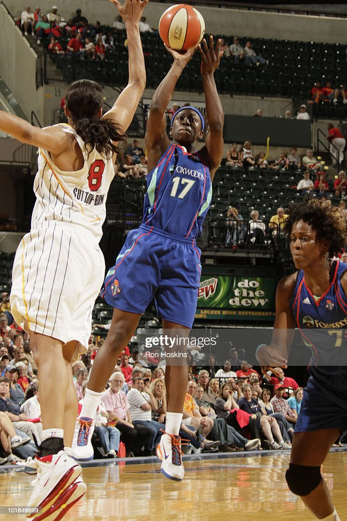 Essence Carson #17 of the New York Liberty shoots over Tammy Sutton-Brown #8 of the Indiana Fever at Conseco Fieldhouse on June 5, 2010 in Indianapolis, Indiana. The Fever defeated the Liberty 78-73.
