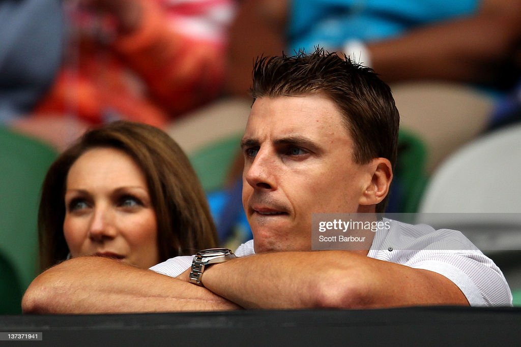 Essendon AFL player Matthew Lloyd watches the third round match between Rafael Nadal of Spain and Lukas Lacko of Slovakia during day five of the 2012...