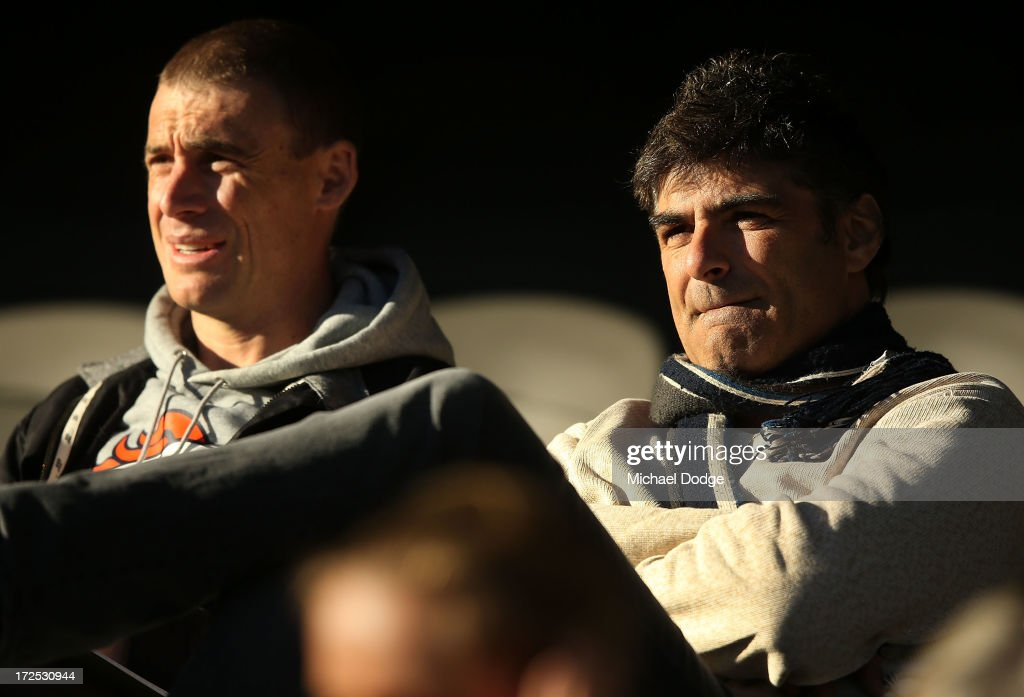 Essendon Bombers assistant coach <a gi-track='captionPersonalityLinkClicked' href=/galleries/search?phrase=Simon+Goodwin&family=editorial&specificpeople=224540 ng-click='$event.stopPropagation()'>Simon Goodwin</a> and recruiting manager Adrian Dodoro look ahead during the AFL Under 18s Championship match between South Australia and Western Australia at Etihad Stadium on July 3, 2013 in Melbourne, Australia.