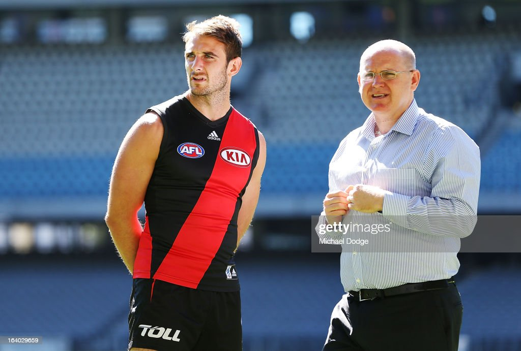 Essendon Bombers captain <a gi-track='captionPersonalityLinkClicked' href=/galleries/search?phrase=Jobe+Watson&family=editorial&specificpeople=235888 ng-click='$event.stopPropagation()'>Jobe Watson</a> was taken off the ground away from the media by AFL Communications manager Patrick Keane during the AFL Captains media Day at Etihad Stadium on March 19, 2013 in Melbourne, Australia.